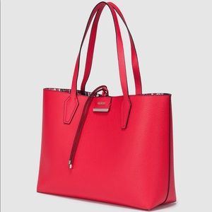 Guess reversible tote with lipstick pattern